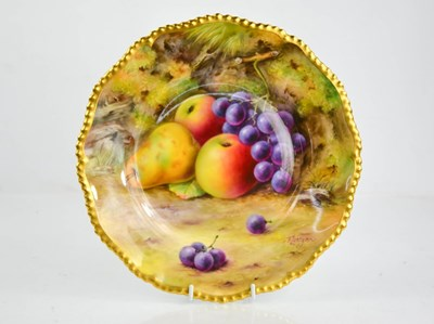 Lot 34 - A Royal Worcester plate painted with fruit on...