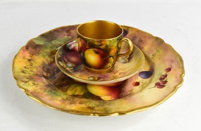 Lot 12 - A Royal Worcester trio painted with fruit, by...