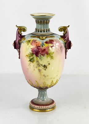 Lot 16 - A Royal Worcester pedesal vase, decorated with...