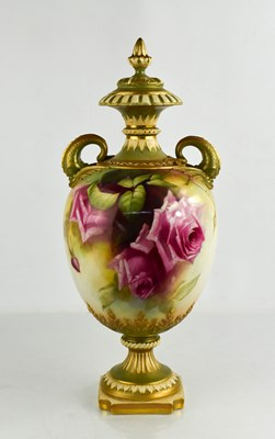Lot 5 - A Royal Worcester pedestal vase and cover by E...