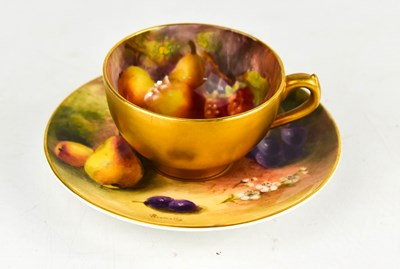 Lot 27 - A Royal Worcester miniature cup and saucer,...