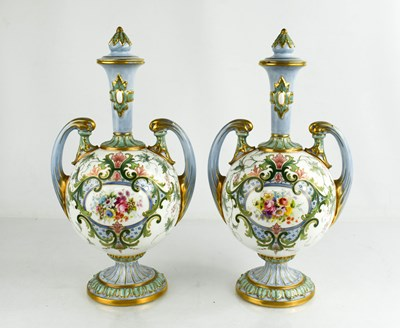 Lot 4 - A pair of Royal Worcester vase and covers,...