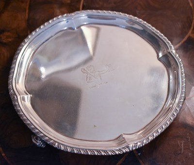 Lot 3 - A small silver salver, engraved with man...