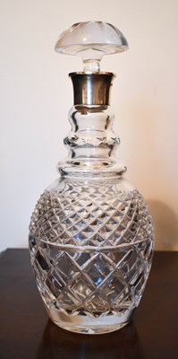 Lot 17 - A cut glass decanter with silver collar and...